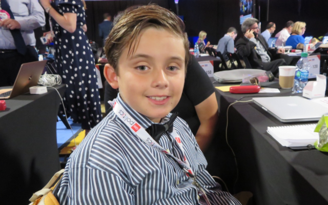 Jefferson Henry Kraft is (probably) the youngest correspondent in the Democratic debate spin room in Detroit on July 30, 2019. (Ron Kampeas/JTA)