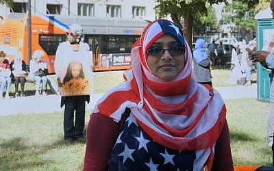 Yemeni-American woman with flag hijab. (Adam Zucker)