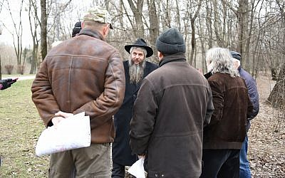 Moshe Azman, a Ukrainian rabbi, discussing with architects the construction of a Holocaust museum near the Babi Yar monument in Kiev, Ukraine on March 14, 2016. (Cnaan Liphshiz)