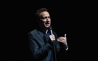 Comedian Elon Gold talks at John Jay College in New York, February 26, 2017. He has incorporated Jew-hatred into his comedy sets for years. (Shahar Azran/Getty Images/via JTA)