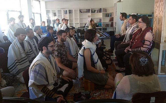 Students meditate as part of the morning prayer at Romemu Yeshiva in New York, July 16, 2019. The yeshiva combines intensive study of Jewish text with mindfulness and mysticism. (Ben Sales)