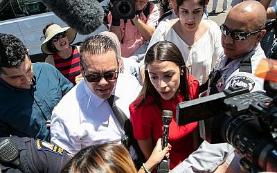 Rep. Alexandria Ocasio-Cortez speaks to the media after visiting the detention facility in Clint, Texas on July 1, 2019. (Christ Chavez/Getty Images/via JTA)