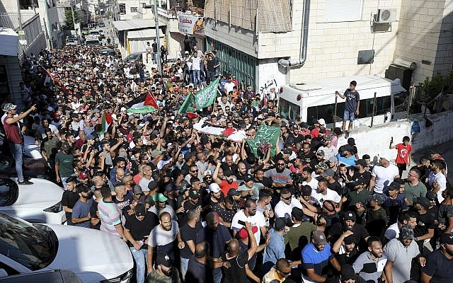 Mourners carry Palestinian and Hamas flags as they accompany the body of Mohammed Obeid, a 20 year-old Palestinian killed in a clashes with Israeli police on June 27, during his funeral in East Jerusalem, July 1, 2019. (AP Photo/Mahmoud Ilean)