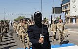 Iraqi Popular Mobilization Forces march in Baghdad, Iraq, May 31, 2019. (Khalid Mohammed/AP)