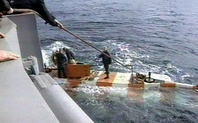 Russia rescue personnel return from a dive in a mini submarine to the Kursk on the sea bed in the Barents Sea, Russia. (RU-RTR Russian Television via AP)
