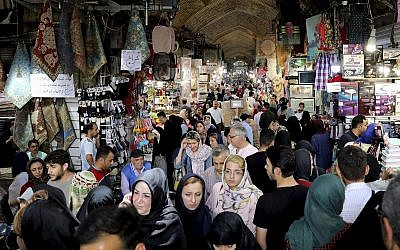 People shopping at the old main bazaar in Tehran, Iran, July 2, 2019. (AP Photo/Ebrahim Noroozi)