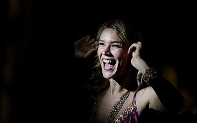 In this November 26, 2016 file photo, British singer Joss Stone laughs as she adjusts her earpiece before performing a concert in Karen, on the outskirts of Nairobi, Kenya. (AP Photo/Ben Curtis, File)