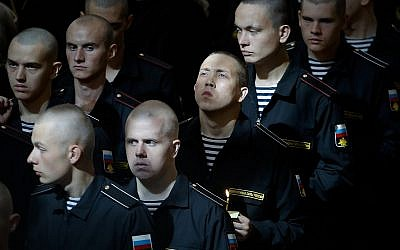 Sailors attend a service to commemorate the 14 crew members who were killed on one of the Russian navy's deep-sea research submersibles at Kronshtadt Navy Cathedral outside St. Petersburg, Russia, Thursday, July 4, 2019. (AP Photo/Dmitri Lovetsky)
