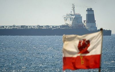 The Grace 1 super tanker, suspected of carrying Iranian crude oil to Syria in violation of EU sanctions, in the British territory of Gibraltar after it was detained, July 4, 2019. (AP Photo/Marcos Moreno)