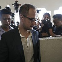 Riza Aziz, stepson of Malaysian former prime minister Najib Razak, walks into a court room at Kuala Lumpur High Court in Kuala Lumpur, Malaysia on July 5, 2019. (AP/Vincent Thian)