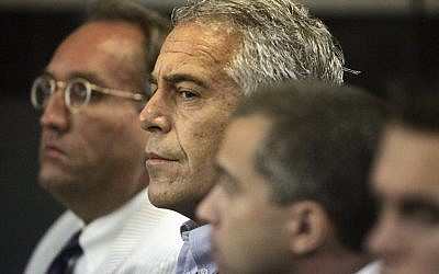 Jeffrey Epstein, center, is shown in custody in West Palm Beach, Florida on July 30, 2008 (Uma Sanghvi/Palm Beach Post via AP, File)