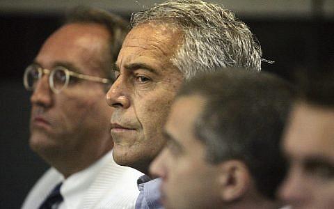 Jeffrey Epstein, center, appears in court in West Palm Beach, Florida, July 30, 2008. (Uma Sanghvi/Palm Beach Post via AP)