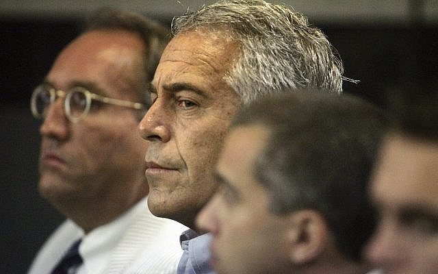 Jeffrey Epstein, center, appears in court in West Palm Beach, Florida, July 30, 2008. (Uma Sanghvi/Palm Beach Post via AP)