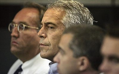 In this file photo from July 30, 2008, Jeffrey Epstein, center, appears in court in West Palm Beach, Florida. (Uma Sanghvi/Palm Beach Post via AP, File)