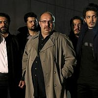 An undated promotional handout still from the Iranian state TV series, 'Gando,' shows actor Payam Dehkordi, center, who plays a character apparently based on Washington Post journalist Jason Rezaian, among other actors. (Mohammad Bagheri/TV series, 'Gando,' via AP)
