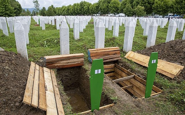 Fresh graves are dug at the memorial cemetery in Potocari near Srebrenica, Bosnia, July 10, 2019. The remains of 33 victims of the Srebrenica massacre were buried 24 years after Serb troops overran the eastern Bosnian Muslim enclave of Srebrenica and executed some 8,000 Muslim men and boys, an event international courts have labeled as an act of genocide. (AP Photo/Darko Bandic)
