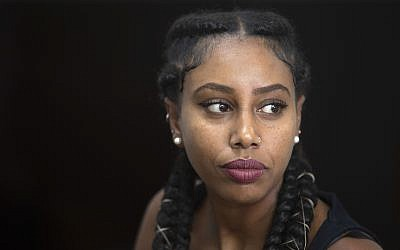 In this Sunday, July 7, 2019 photo, Ethiopian-Israeli musician Yael Mentesnot gives an interview to The Associated Press, in her house in Tel Aviv (AP Photo/Sebastian Scheiner)