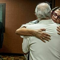 Tanya Gersh, a Montana real estate agent, embraces her father Lloyd Rosenstein following a hearing at the Russell Smith Federal Courthouse on July 11, 2019, in Missoula, Montana. (Ben Allen/The Missoulian via AP)