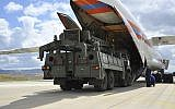 Military vehicles and equipment, parts of the S-400 air defense systems, are unloaded from a Russian transport aircraft at Murted military airport in Ankara, Turkey, July 12, 2019. (Turkish Defense Ministry via AP, Pool)