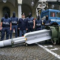 Police stand by a missile seized at an airport hangar near Pavia, northern Italy, following an investigation into Italians who took part in the Russian-backed insurgency in eastern Ukraine, in Turin on July 15, 2019. (Tino Romano/ANSA via AP)