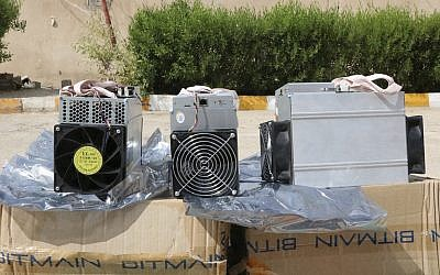This undated photo provided by the Police News Agency, shows boxes of machinery used in Bitcoin 'mining' operations that were confiscated by police in Nazarabad, Iran. (News.police.ir via AP)