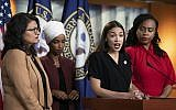 "US Rep. Alexandria Ocasio-Cortez, D-N.Y., speaks as, from left, Rep. Rashida Tlaib, D-Mich., Rep. Ilhan Omar, D-Minn., and Rep. Ayanna Pressley, D-Mass., listen during a news conference at the Capitol in Washington, Monday, July 15, 2019. President Donald Trump on Monday intensified his incendiary comments about the four Democratic congresswomen of color, urging them to get out if they don't like things going on in America. They fired back at what they called his ""xenophobic bigoted remarks"" and said it was time for impeachment. (AP Photo/J. Scott Applewhite)"