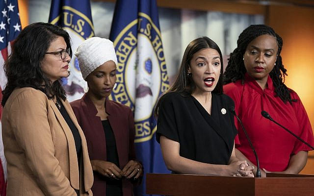 US Rep. Alexandria Ocasio-Cortez speaks as, from left, Reps. Rashida Tlaib, Ilhan Omar and Ayanna Pressley listen during a news conference at the Capitol in Washington, July 15, 2019. (AP Photo/J. Scott Applewhite)