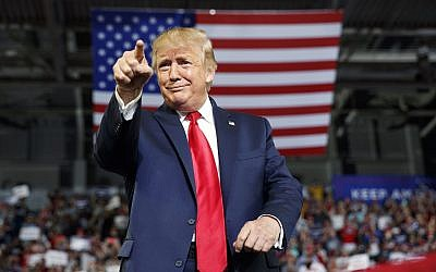 US President Donald Trump gestures to the crowd as he arrives to speak at a campaign rally at Williams Arena in Greenville, North Carolina, July 17, 2019. (Carolyn Kaster/AP)