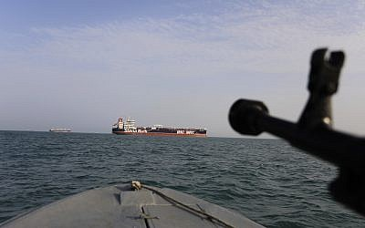 In this July 21, 2019 photo, a speedboat of the Iran's Revolutionary Guard moves around a British-flagged oil tanker Stena Impero which was seized in the Strait of Hormuz on Friday by the Guard, in the Iranian port of Bandar Abbas. (Morteza Akhoondi/Mehr News Agency via AP)