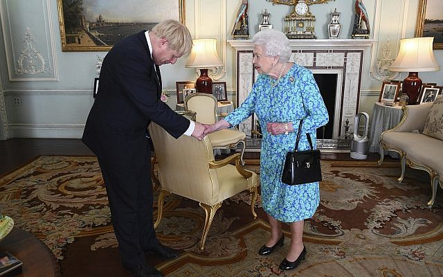 Britain's Queen Elizabeth II welcomes newly elected leader of the Conservative party Boris Johnson during an audience at Buckingham Palace, London, Wednesday July 24, 2019, where she invited him to become Prime Minister and form a new government. (Victoria Jones/Pool via AP)