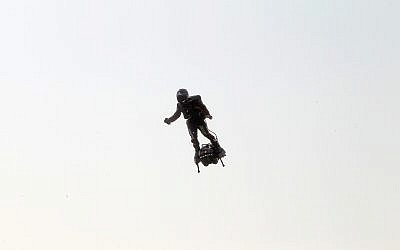 Franky Zapata, a 40-year-old inventor, takes to the air in Sangatte, northern France, at the start of his attempt to cross the channel from France to England, July 25, 2019. (AP Photo/Michel Spingler)