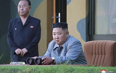 In this July 25, 2019, photo provided on July 26, 2019, by the North Korean government, North Korean leader Kim Jong Un watches a missile test in North Korea. (Korean Central News Agency/Korea News Service via AP)