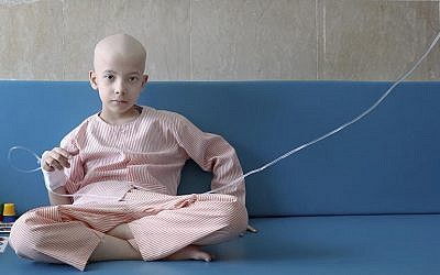In this June 19, 2019 photo, Taha Shakouri, an 8-year-old boy suffering from liver cancer, sits in his room at Mahak Children's Hospital in Tehran, Iran (AP Photo/Ebrahim Noroozi)
