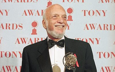 Harold Prince holds his Tony award for best director in a musical for 'Show Boat,' at Broadway's Minskoff Theater in New York, June 4, 1995. (AP Photo/Richard Drew, File)