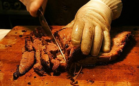 Illustrative: Texas style brisket Tuesday, June 14, 2005, in Reynoldsburg, Ohio. (AP Photo/Kiichiro Sato)