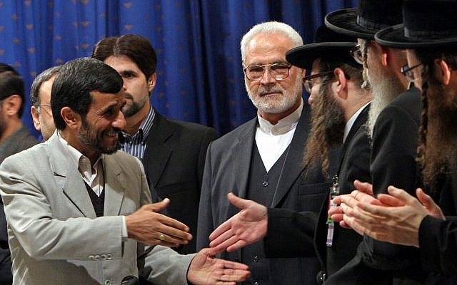 Iranian President Mahmoud Ahmadinejad, left, shakes hands with anti-Zionism Rabbi Yisroel Dovid Weiss, of Monsey, N.Y., at the start of a conference on the Holocaust, in Tehran, Dec. 12, 2006. Ahmadinejad initiated the two-day gathering. (AP Photo/Hasan Sarbakhshian)
