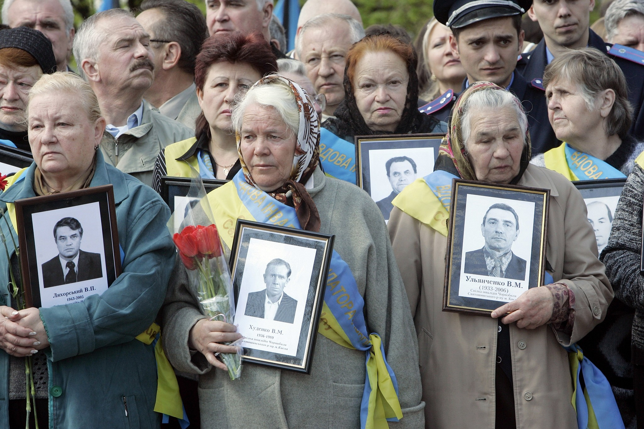 The widows of Chernobyl victims hold portraits of their husbands who died following the clean-up operations for the 1986 Chernobyl nuclear explosion, at Chernobyl's victim monument in Ukraine's capital Kiev, Saturday, April 26, 2008. (AP Photo/Efrem Lukatsky)