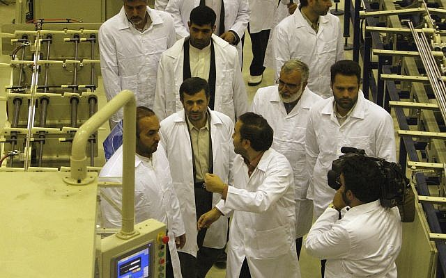 Iranian President Mahmoud Ahmadinejad, bottom second left, visits Iran's Fuel Manufacturing Plant (FMP), a new facility producing uranium fuel for a heavy-water nuclear reactor, just outside the city of Isfahan 255 mile (410 kilometers) south of the capital Tehran, Iran, Thursday, April 9, 2009. (AP Photo/Vahid Salemi)