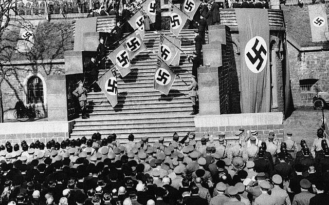 A general view of the flag ceremony in Hindenburg Park in Cologne, Germany on March 8, 1936. Nazi storm troopers ceremoniously celebrated the German remilitarization of the Rhineland and repudiation of the Versailles treaty in a colorful demonstration in Hindenburg, the site of the oldest fort on the Rhine. The demonstration was held in connection with the German day of national mourning observances. (AP Photo)