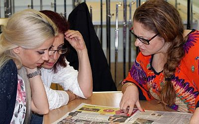 Illustrative: In this photo taken on Thursday, July 28, 2016, two Syrian refugees, left, concentrate during an English lesson with a volunteer teacher in London. As the UK struggles to implement its commitment to resettle more than 20,000 Syrians, the government is counting on charities and community groups to help the newcomers adjust to life in Britain. The Home Office has for the first time set up a program to allow local organizations to sponsor refugees and the agency's website directs volunteers to migrant charities that need their help. (AP Photo/Adela Suliman)
