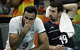 Iranian volleyball players Adel Gholami (L) and Mahdi Marandi after losing a men's quarterfinal volleybal lmatch against Italy at the 2016 Summer Olympics in Rio de Janeiro, Brazil, August 17, 2016. (AP Photo/Matt Rourke/File)