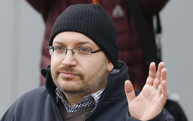 US journalist Jason Rezaian waves as he poses for media people in front of Landstuhl Regional Medical Center in Landstuhl, Germany, after being released from prison in Iran, January 20, 2016. (Michael Probst/AP)