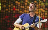 Chris Martin of Coldplay performs at Metlife Stadium on Tuesday, August 1, 2017, in East Rutherford, N.J. (Scott Roth/Invision/AP)