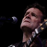 In this photo taken on Nov. 11, 2017, musician Johnny Clegg on stage at a farewell concert in Johannesburg (AP Photo/Denis Farrell)