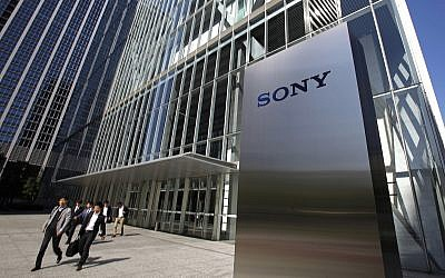 In this April 28, 2017, file photo, people walk out of the headquarters of Sony Corp. in Tokyo (AP Photo/Shuji Kajiyama, File)