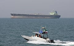 File: An Iranian Revolutionary Guard speedboat moves in the Persian Gulf while an oil tanker is seen in background, July 2, 2012 (AP Photo/Vahid Salemi, File)