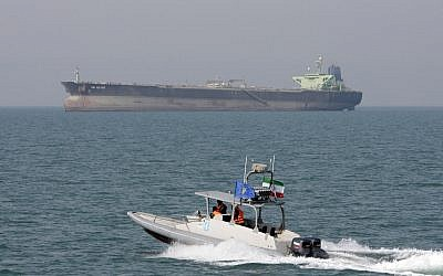 Illustrative: An Iranian Revolutionary Guard speedboat moves in the Persian Gulf with an oil tanker in the background. (AP Photo/Vahid Salemi, File)