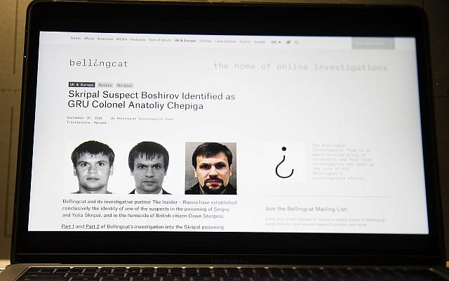 This Thursday, Sept. 27, 2018 file photo shows the website for British investigative group Bellingcat with one of the two suspects in the March poisoning of Sergei Skripal and his daughter in England. (AP/Alexander Zemlianichenko)