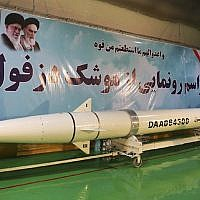 In this photo from February 7, 2019, by Sepahnews, the website of the Iranian Revolutionary Guard, a Dezful surface-to-surface ballistic missile is displayed in an undisclosed location in Iran. (Sepahnews via AP)