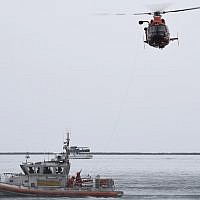 Illustrative -- A US Coast Guard Station Los Angeles-Long Beach 45-foot Response Boat-Medium crew conducts a hoist demonstration with a Coast Guard Air Station San Francisco-Forward Operating Base Point Mugu MH-65 Dolphin helicopter crew in the Port of Los Angeles, on March 21, 2019 (Seaman Ryan Estrada/U.S. Coast Guard via AP)